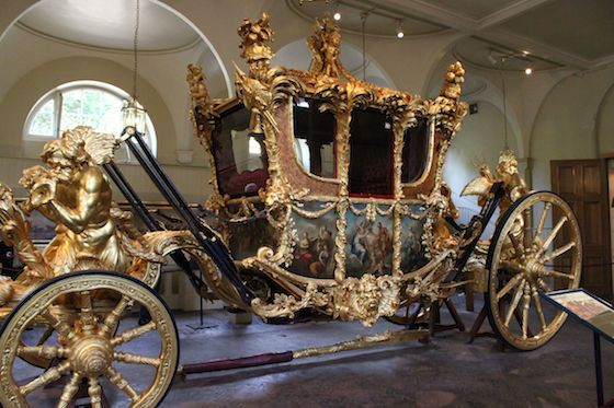 See the Gold State Coach at the Royal Mews