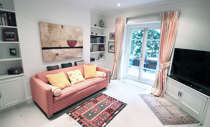 Comfy den and TV room of the Christchurch vacation rental offered by London Perfect