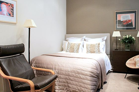 Cosy bedroom with queen bed and armchair