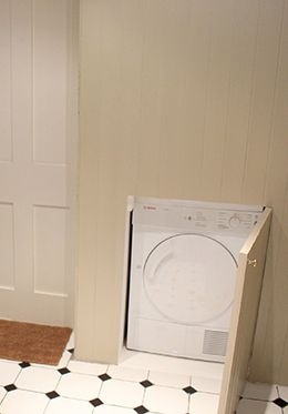 Separate washer and dryer cleverly hidden away!