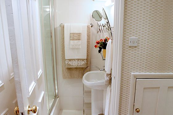 Bathroom with shower and sink in London studio