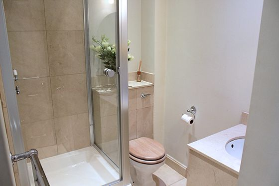Full bathroom on ground level with shower, toilet and sink