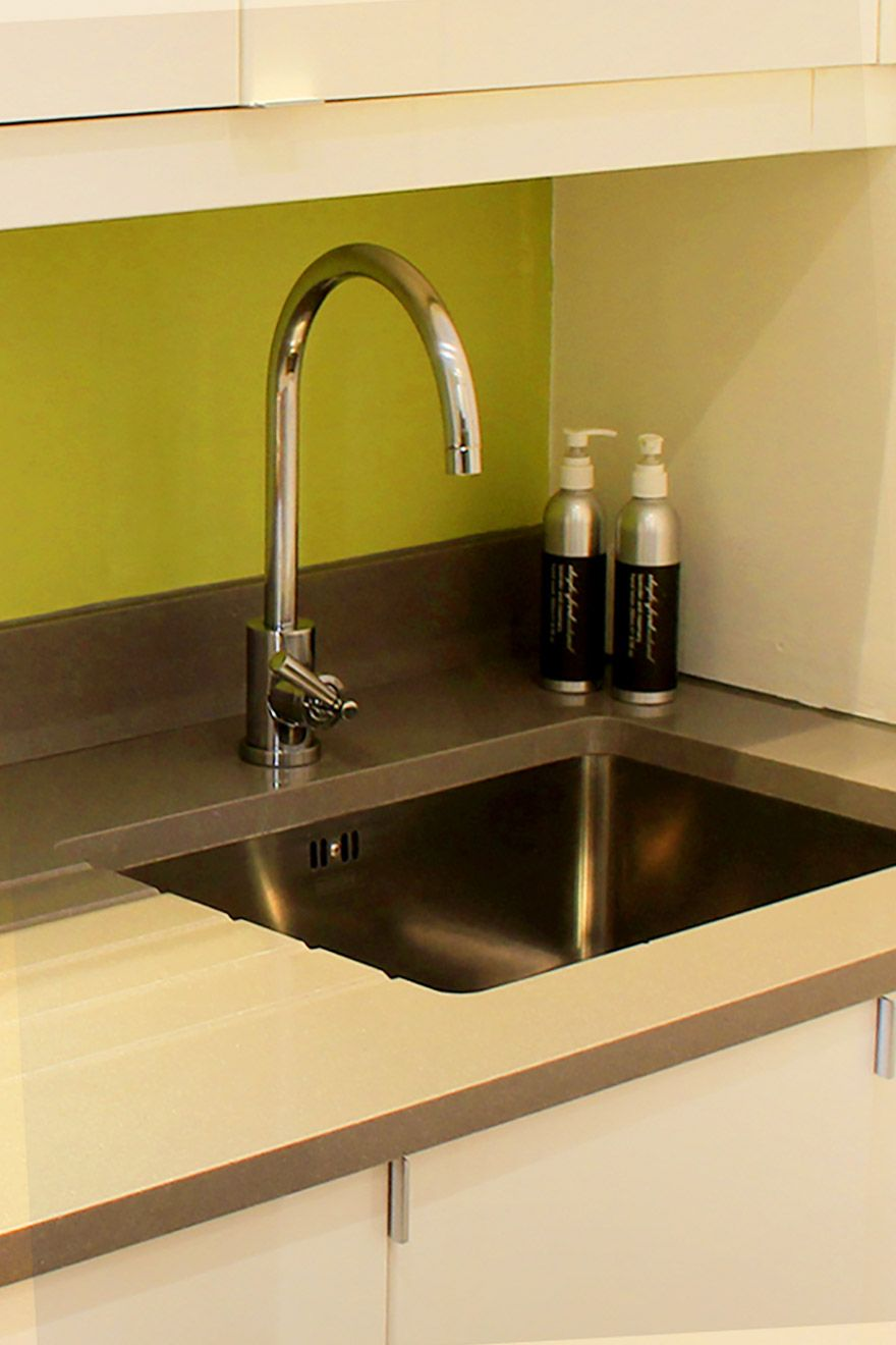 Stainless steel faucet makes up the kitchen sink in the Belgravia vacation rental offered by London Perfect