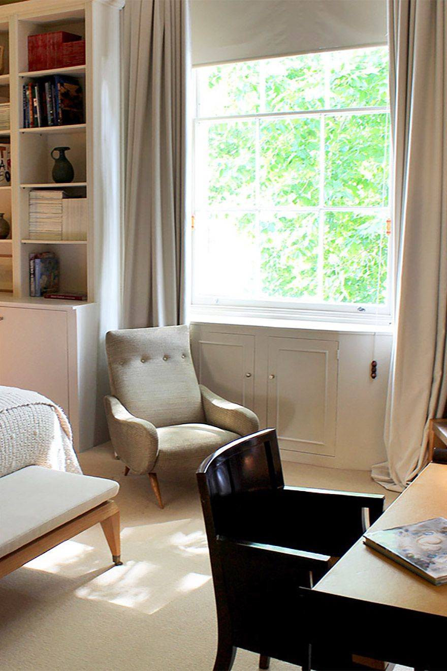 Large window and armchair in the Belgravia vacation rental offered by London Perfect