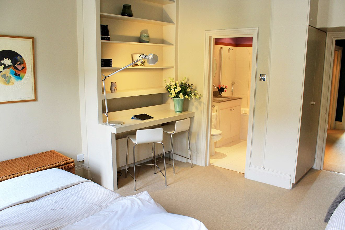Second bedroom with en suite bathroom and writing desk