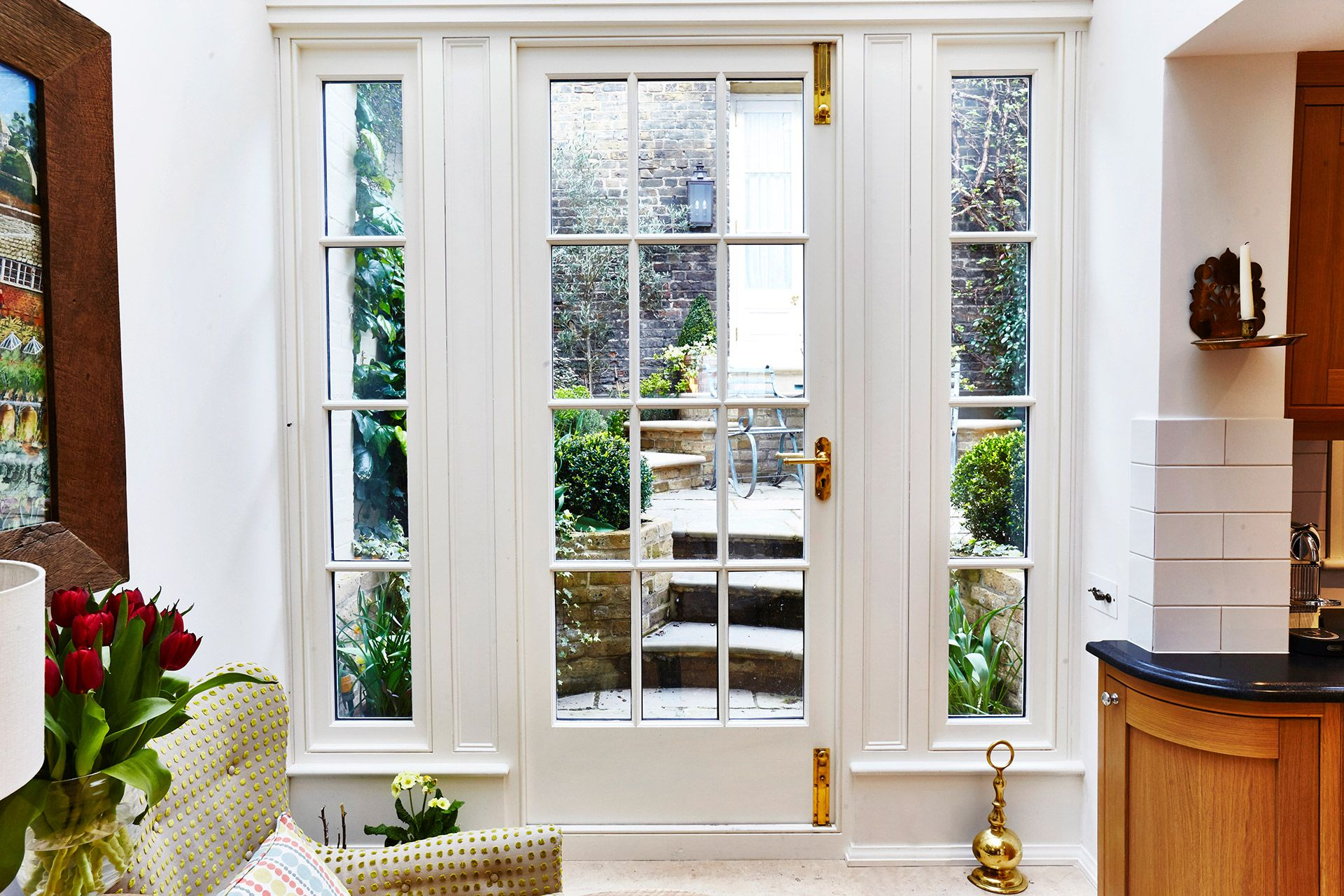 Conservatory opens into the garden of the Wellington rental offered by London Perfect