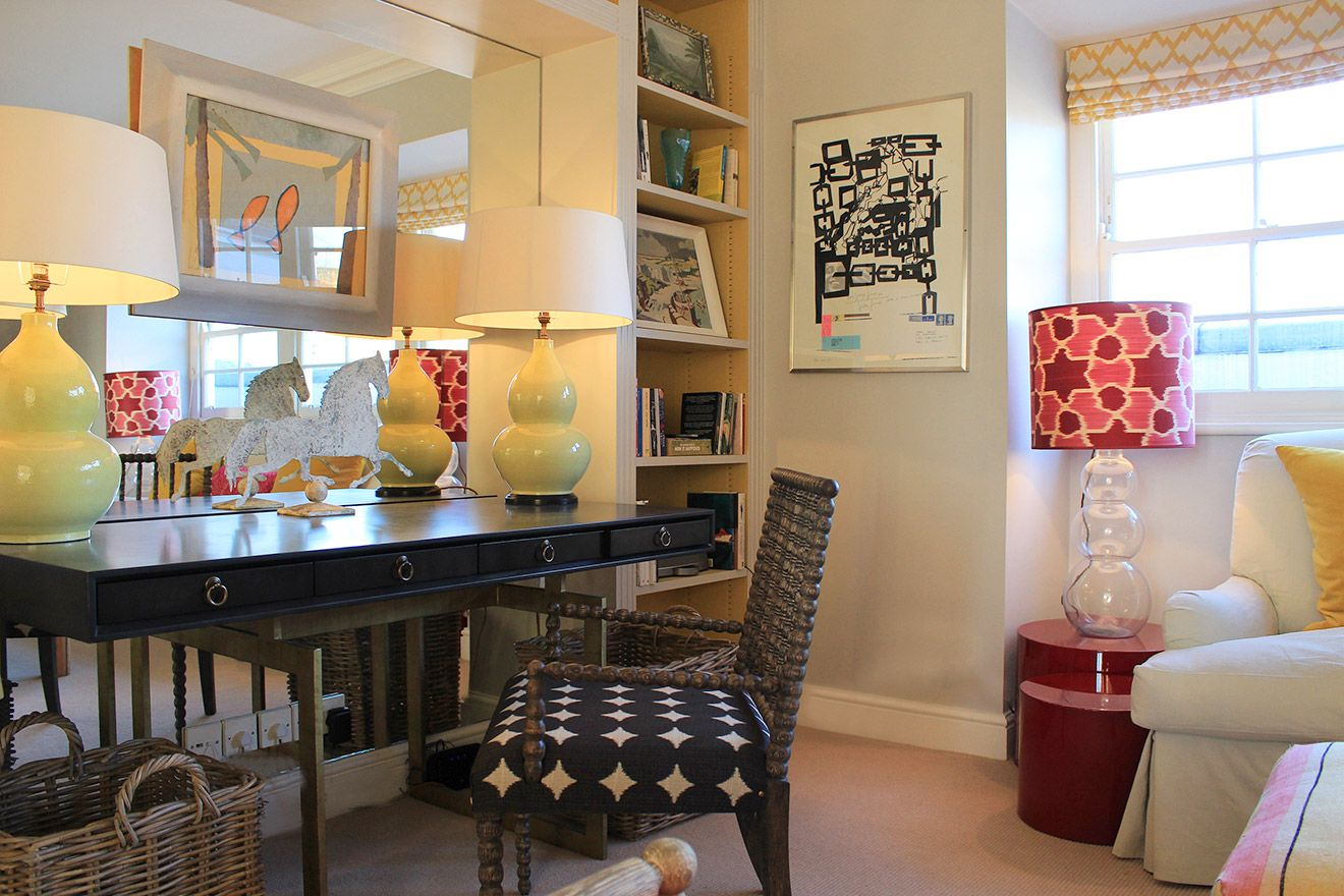 Writing desk in the living room with artwork and sculpture in the Cavendish vacation rental