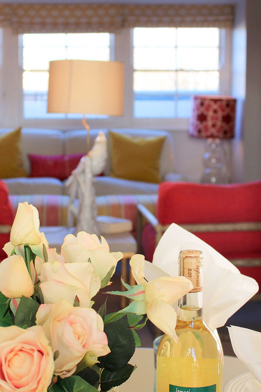 Flowers and wine in living room of the Cavendish vacation rental offered by London Perfect