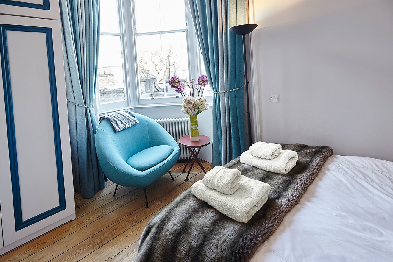 Large window in second bedroom of The Gloucester vacation rental offered by London Perfect