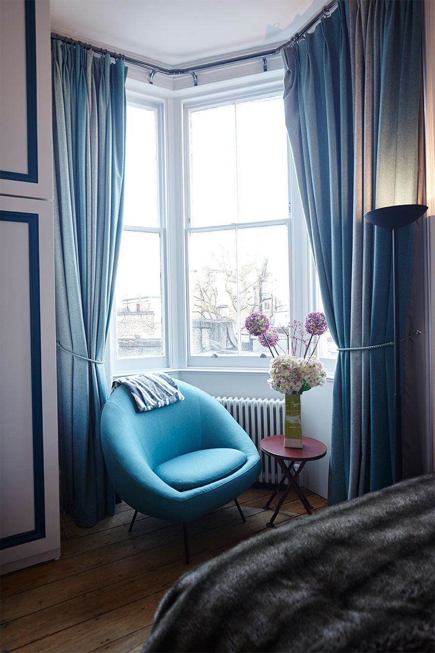 Stylish chair in second bedroom of The Gloucester vacation rental offered by London Perfect