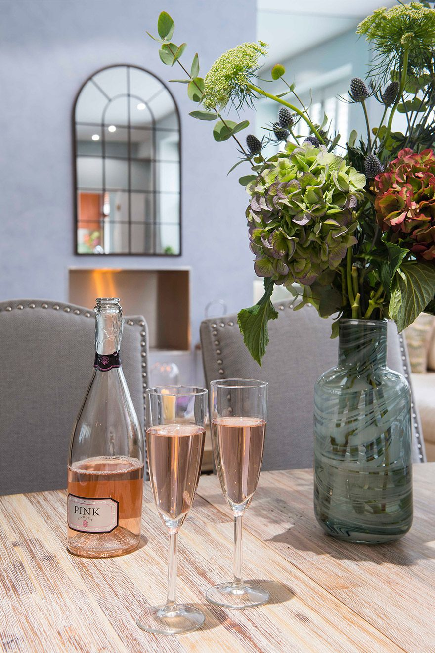 Chilled rosé on dining table and seating area in the Eldon vacation rental