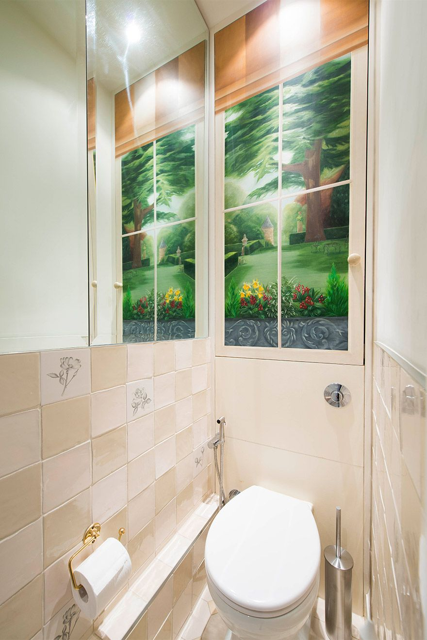 Powder room with toilet and sink in the Eldon vacation rental offered by London Perfect