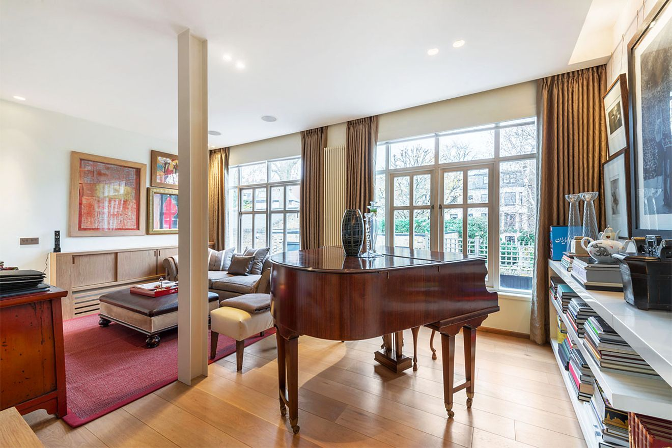 A stunning grand piano in the sitting room of the Attlee vacation rental offered by London Perfect