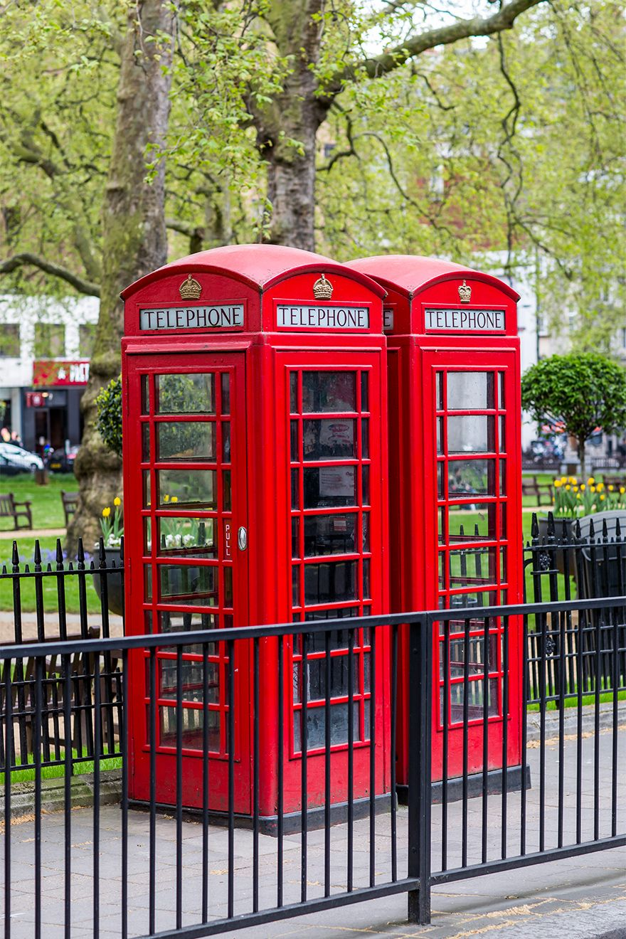 Two iconic red phone booths in London