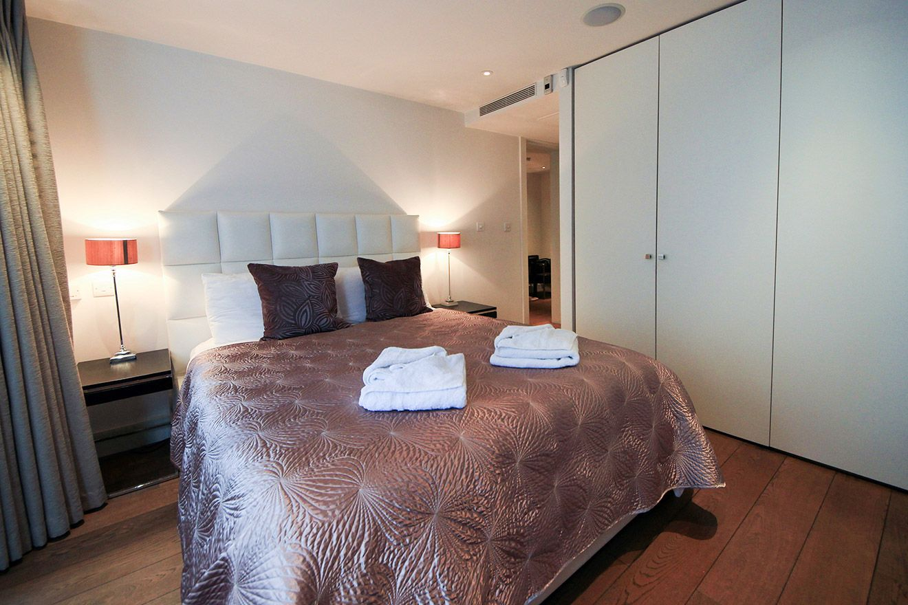 Large cupboards in the first bedroom of the Gladstone vacation rental offered by London Perfect