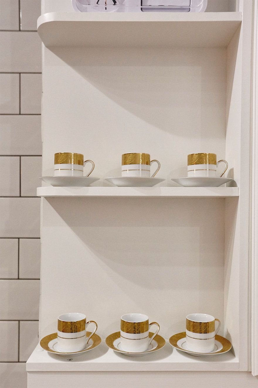 Gold trimmed coffee cups in the MacDonald vacation rental offered by London Perfect
