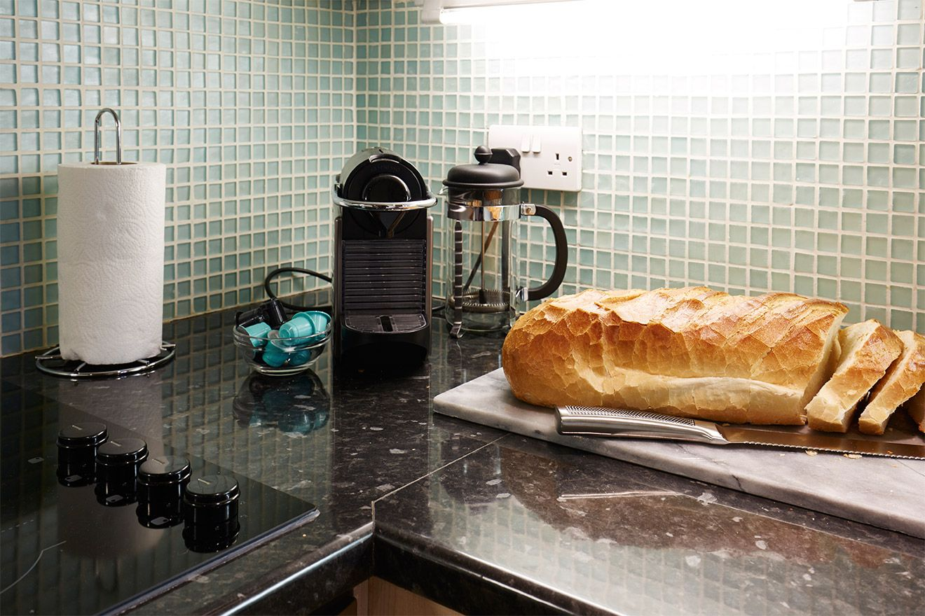 Food preparation area of The Queensgate Studio Loft vacation rental offered by London Perfect