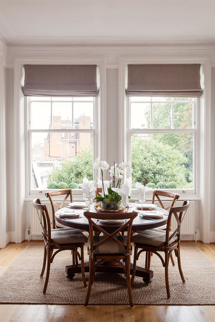 Dining table in the light filled window nook of the Austen vacation rental offered by London Perfect