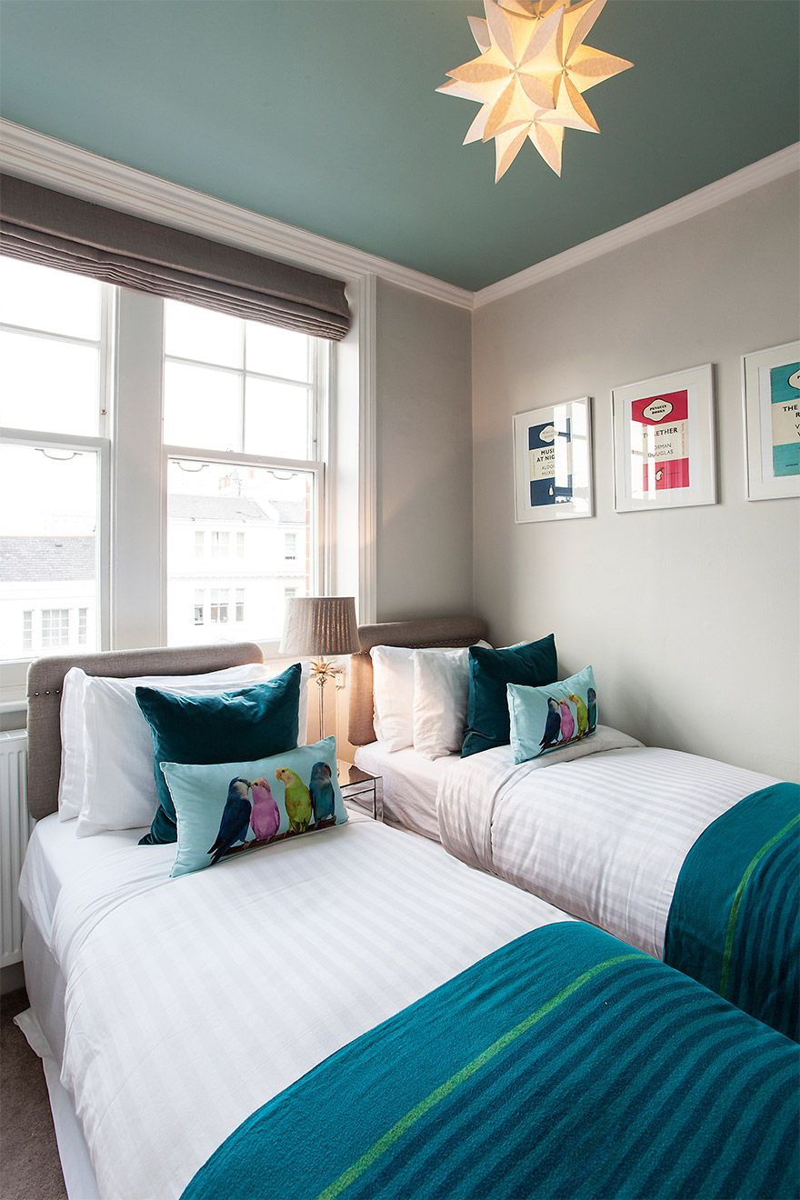 Fun and colorful decor in the second bedroom of the Austen vacation rental offered by London Perfect