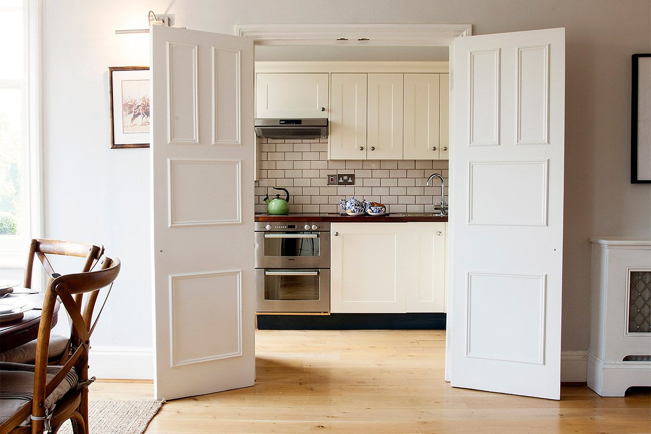 Large doors open to modern kitchen of the Austen vacation rental offered by London Perfect