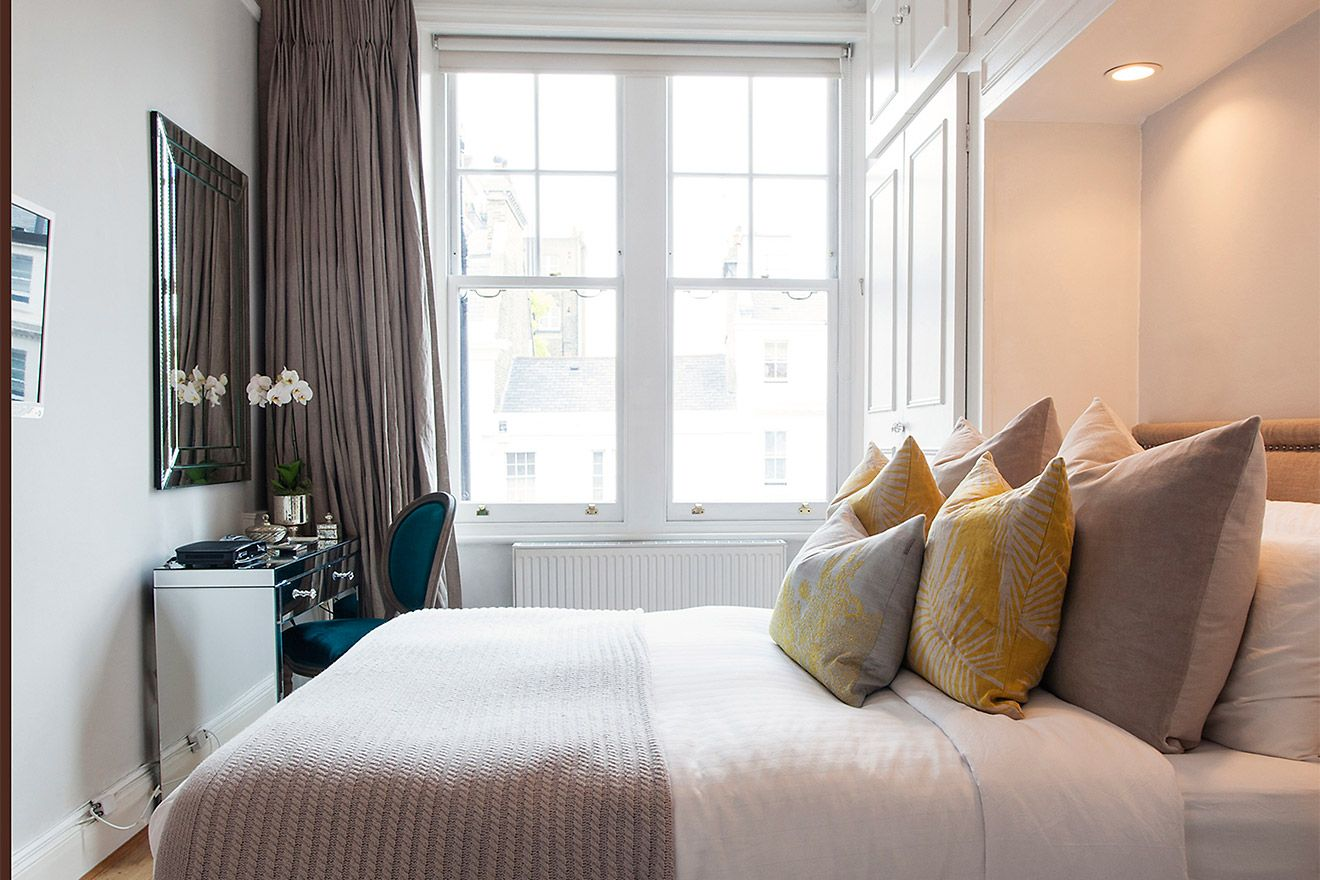 Light filled first bedroom in the Austen vacation rental offered by London Perfect
