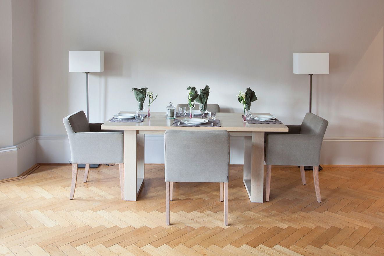 Dining table comfortably seats four in the Sloane vacation rental offered by London Perfect