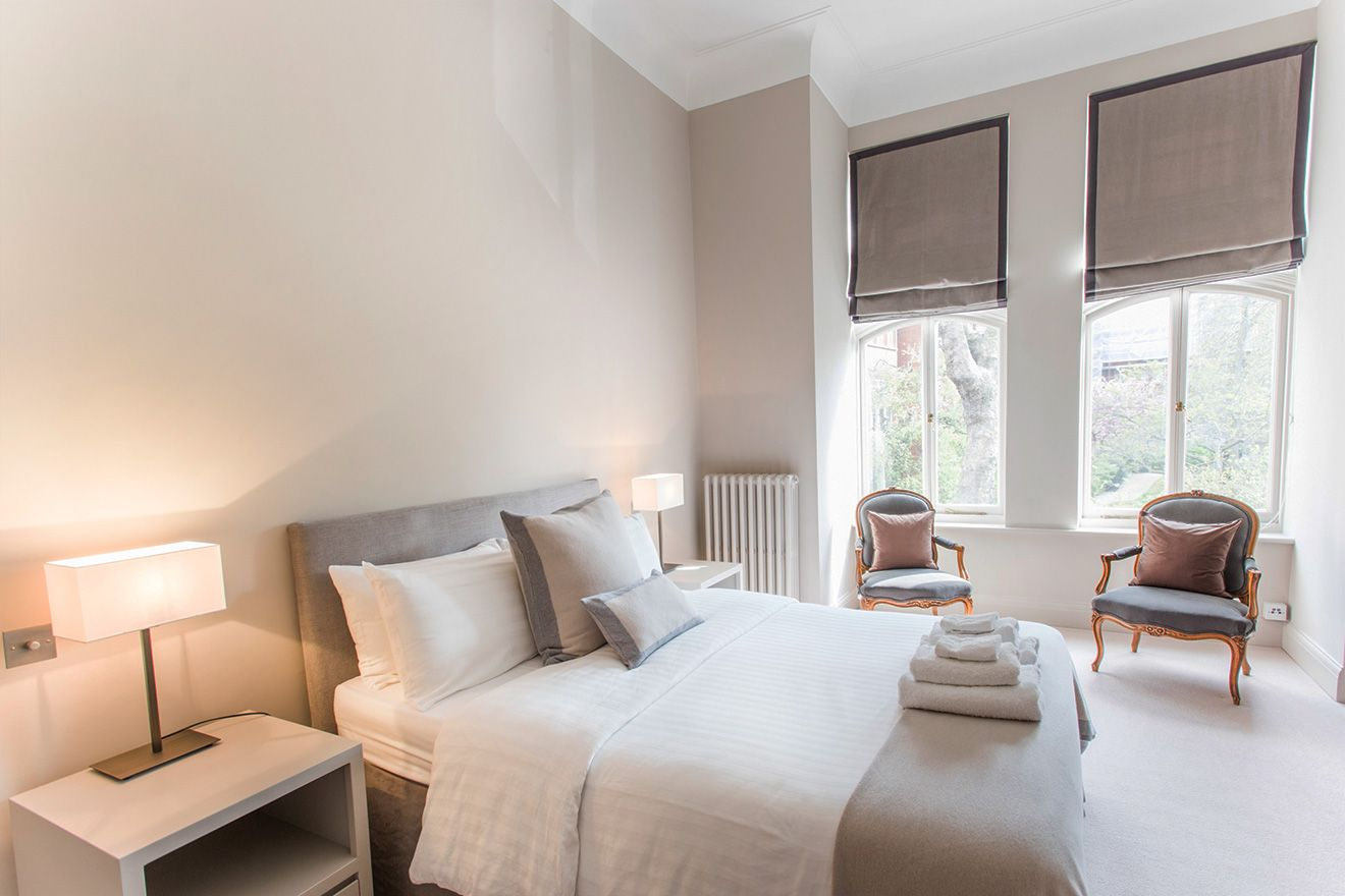 Comfortable and stylish first bedroom of the Sloane vacation rental offered by London Perfect