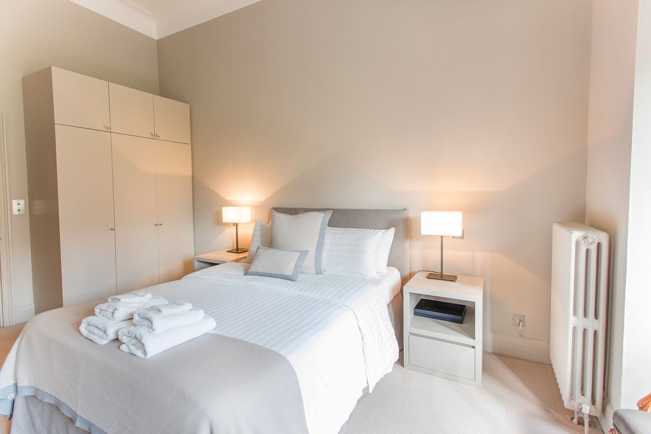 Spacious first bedroom of the Sloane vacation rental offered by London Perfect