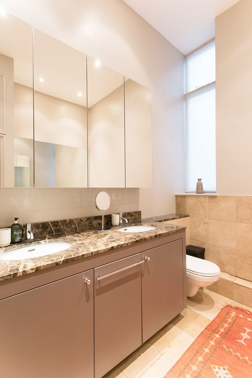 Tall mirrors and double sinks in the Sloane vacation rental offered by London Perfect
