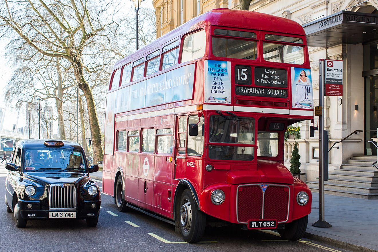 Red double decked bus and Black Taxi in London