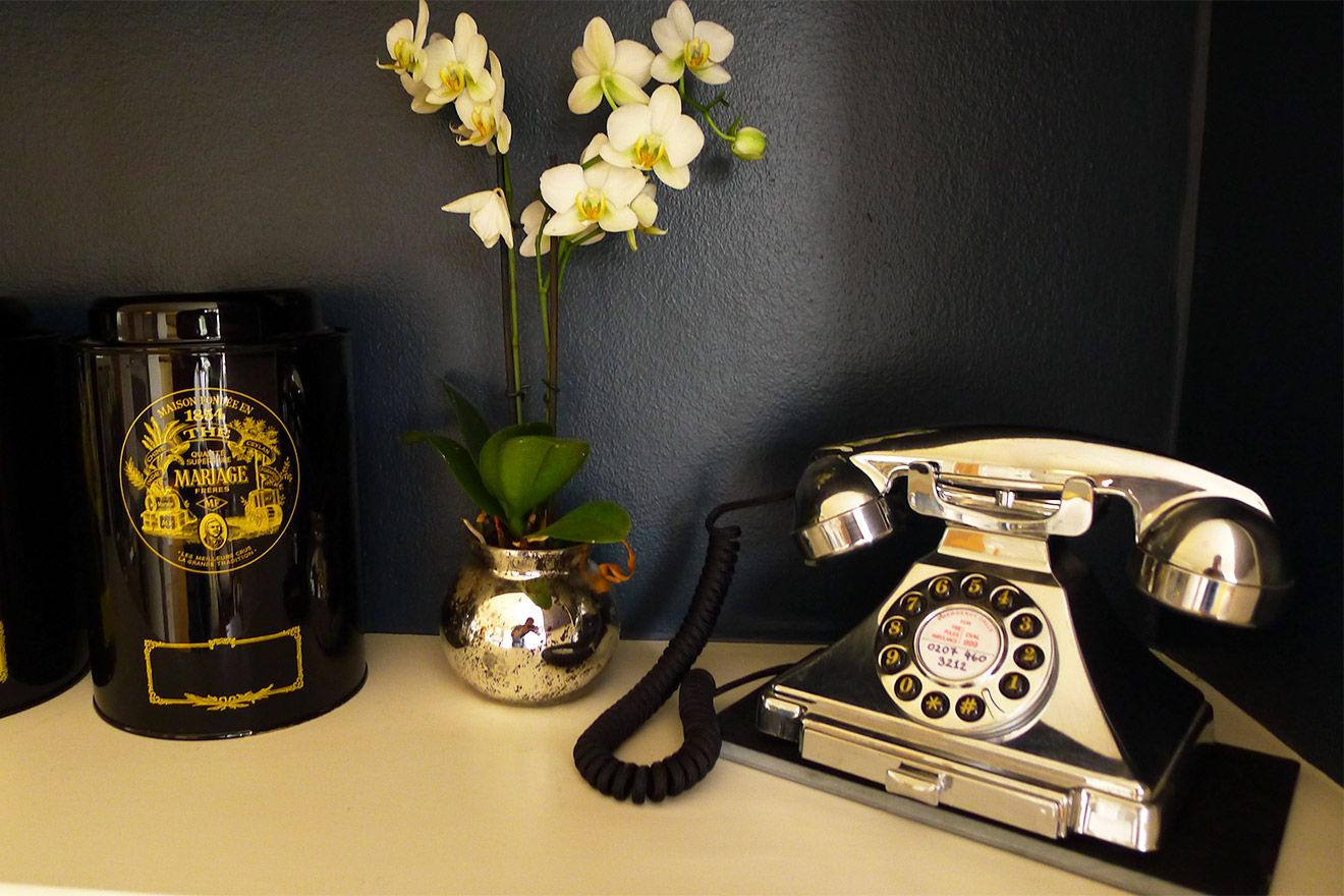 Gold vintage ornamental telephone in the Austen vacation rental offered by London Perfect