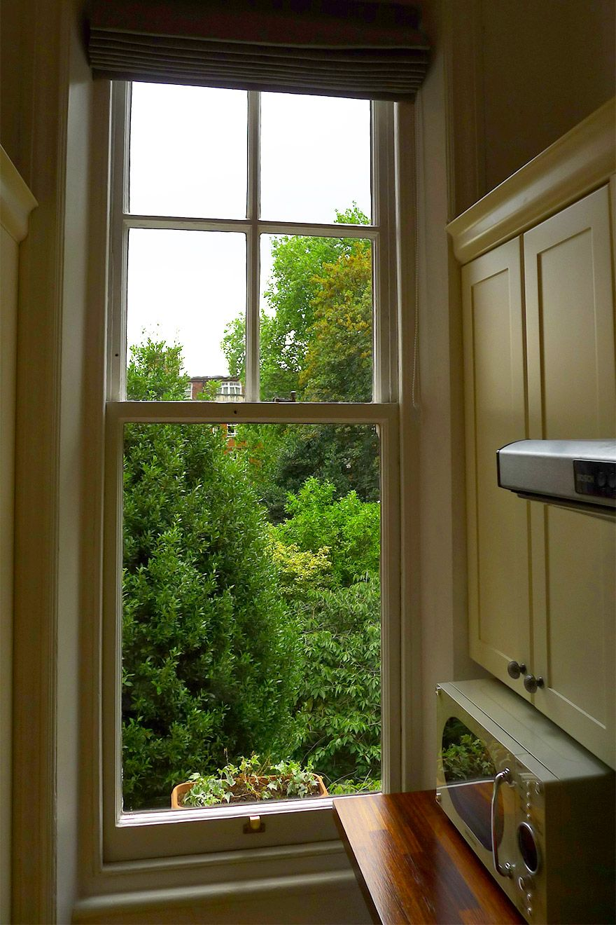 Kitchen window looking onto gardens below in the Austen vacation rental offered by London Perfect