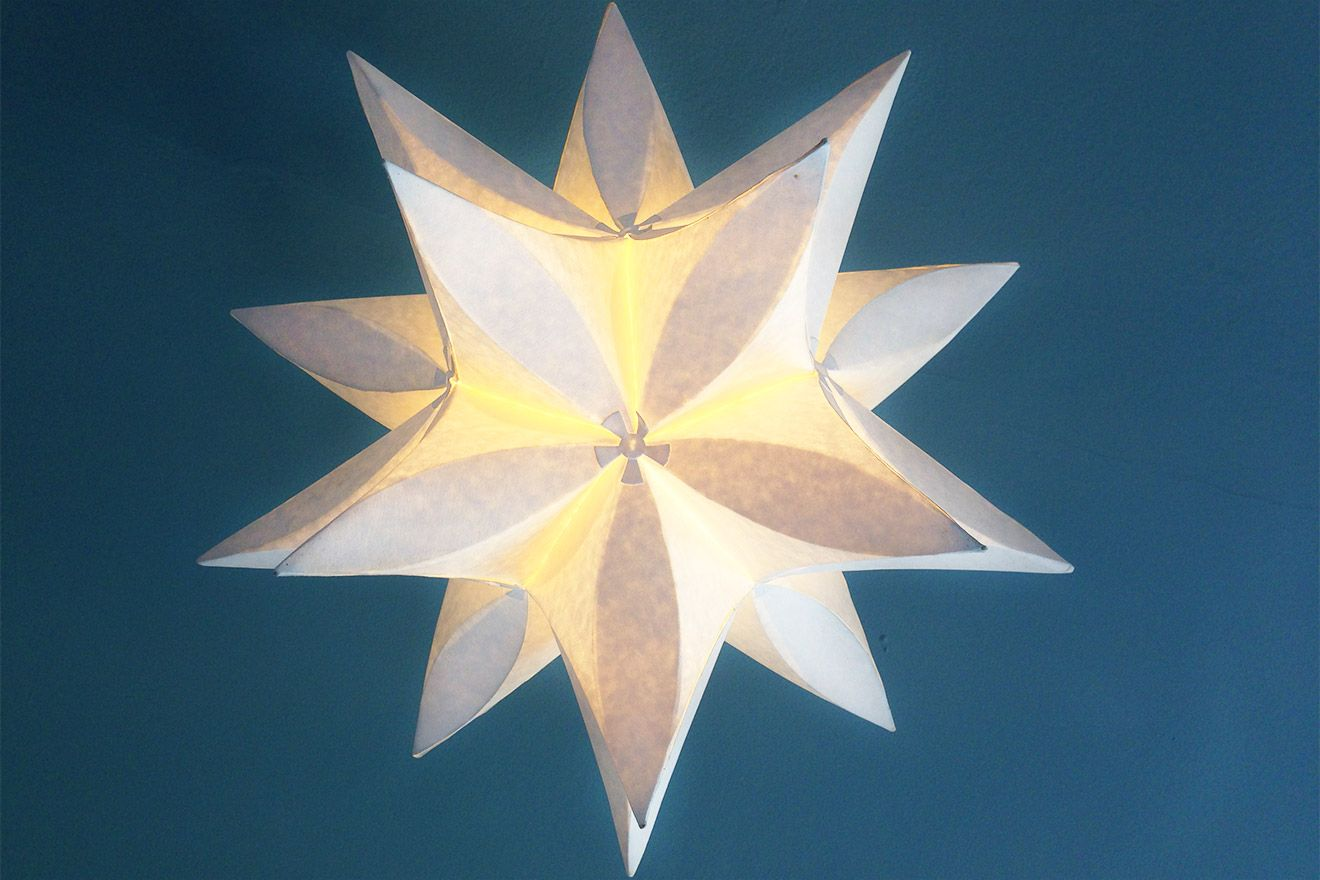 Star shaped light fixture in the Austen vacation rental offered by London Perfect