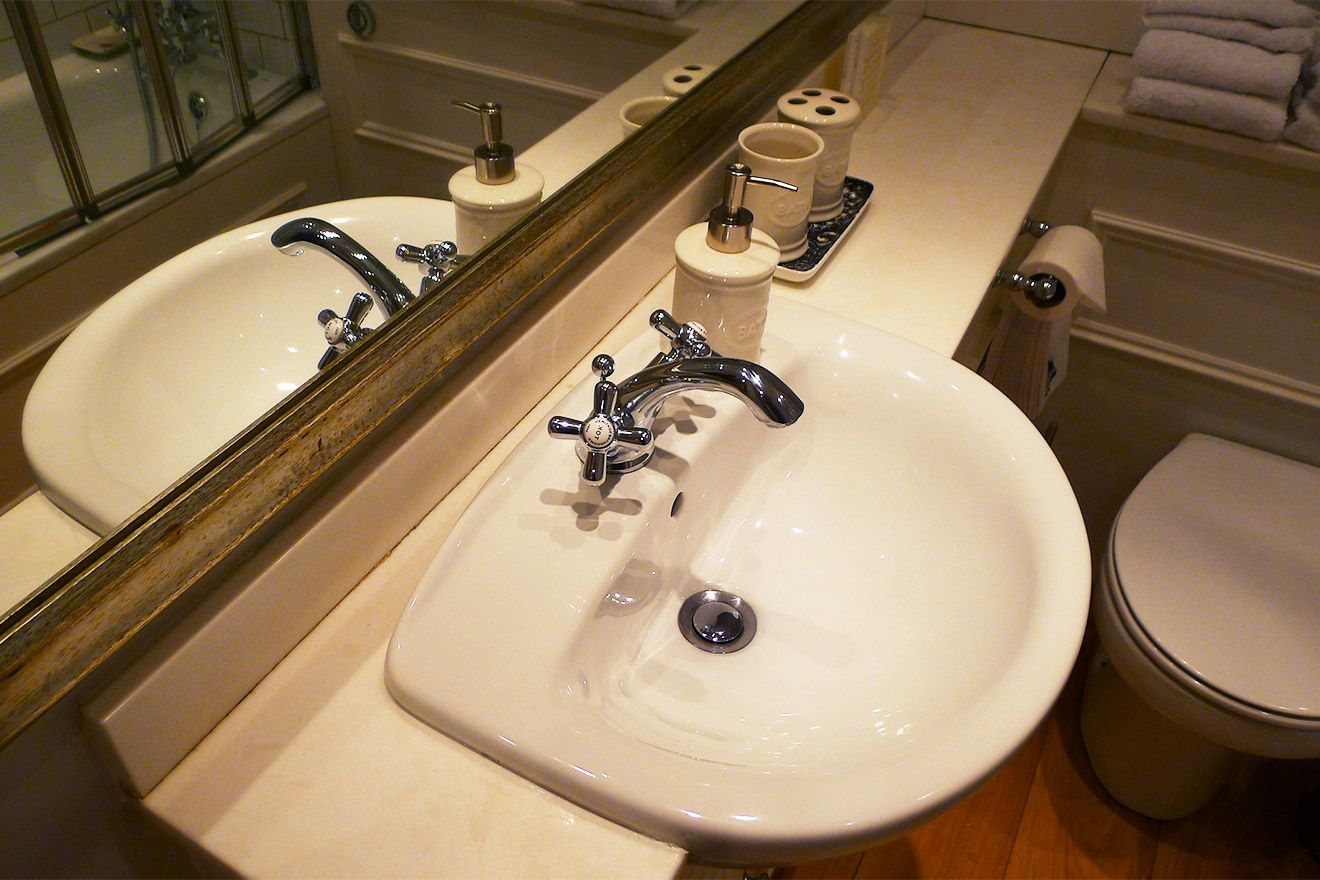 Fashionable fixtures in master bathroom of the Austen vacation rental offered by London Perfect