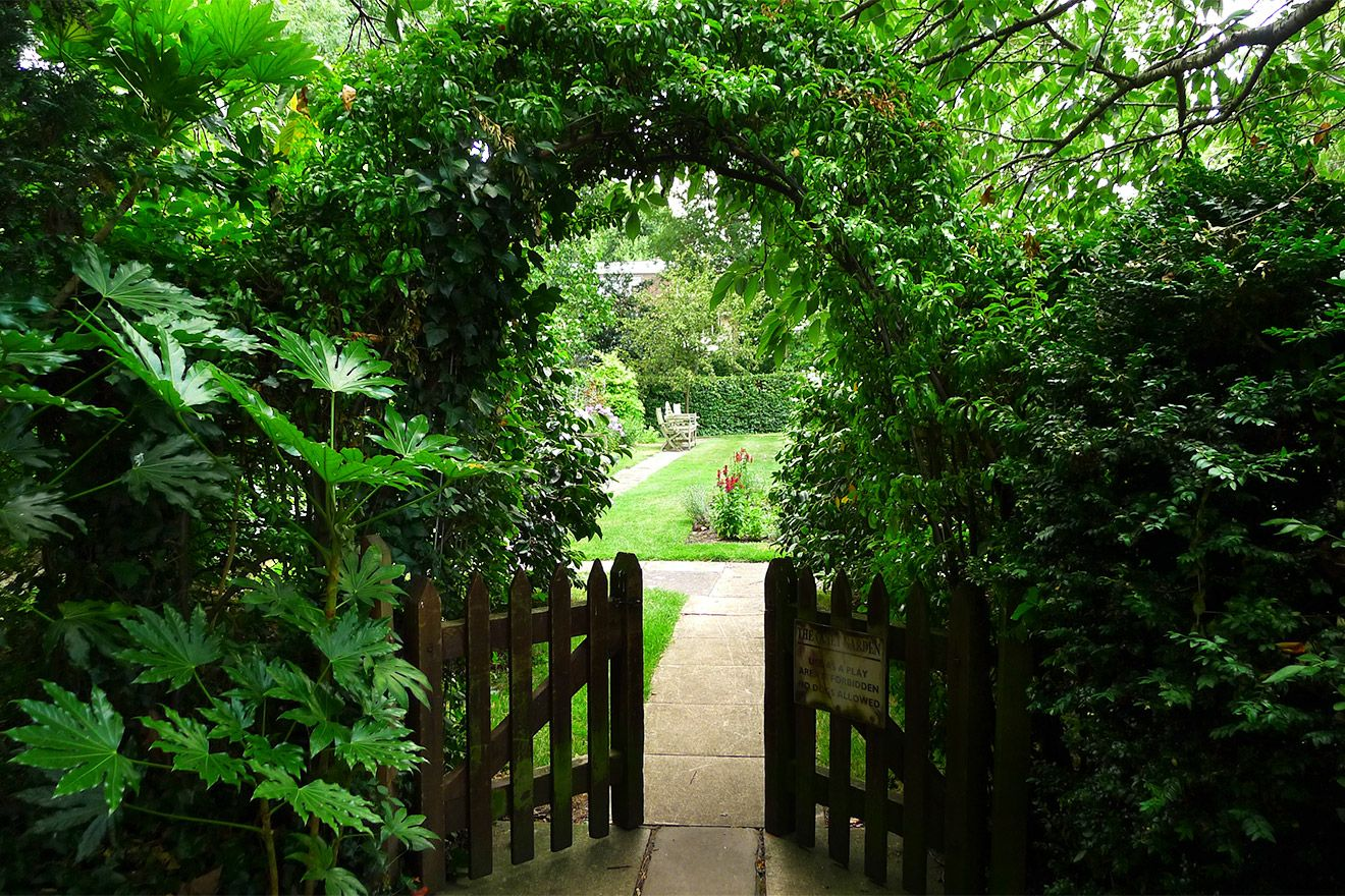 A secluded entrance to the shared garden in the Austen vacation rental offered by London Perfect