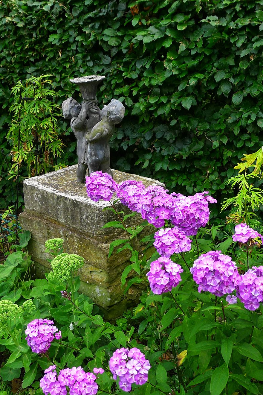 Stone Statue in Garden of the Austen vacation rental offered by London Perfect