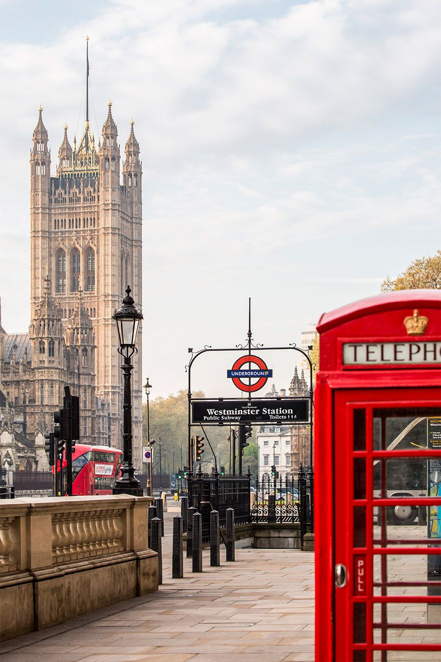 An iconic red phone booth, tube station & Westminster Palace