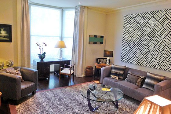 Stylish living room with large bay window in the Chatham vacation rental offered by London Perfect