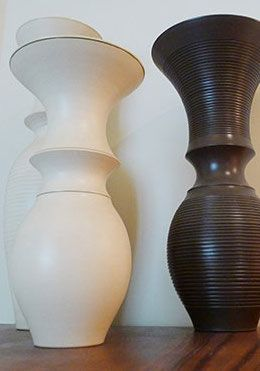 Modern vases atop an antique cupboard in the Chatham vacation rental offered by London Perfect