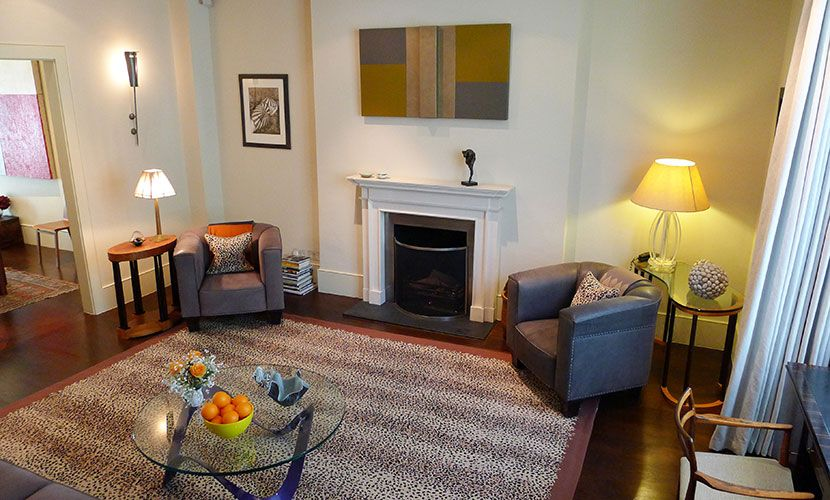 Decorative Fireplace and armchairs in the Chatham vacation rental offered by London Perfect