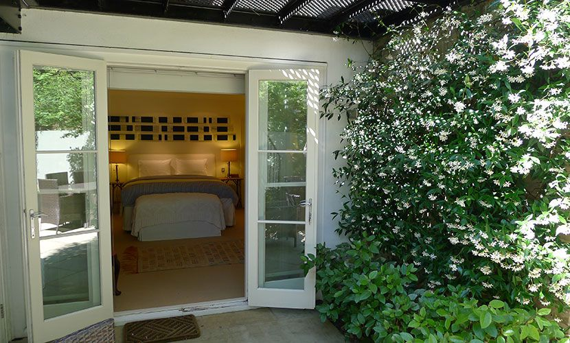 Doors to first bedroom from garden of the Chatham vacation rental offered by London Perfect