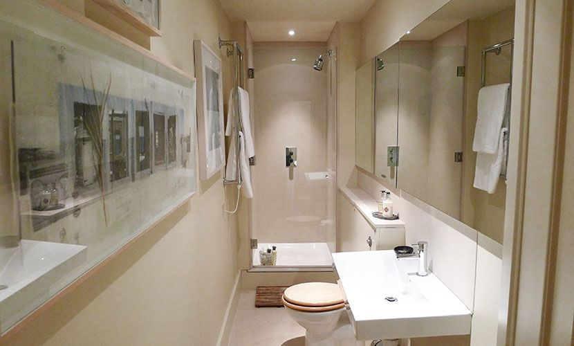 Second bathroom with walk-in shower, toilet and sink in the Chatham vacation rental