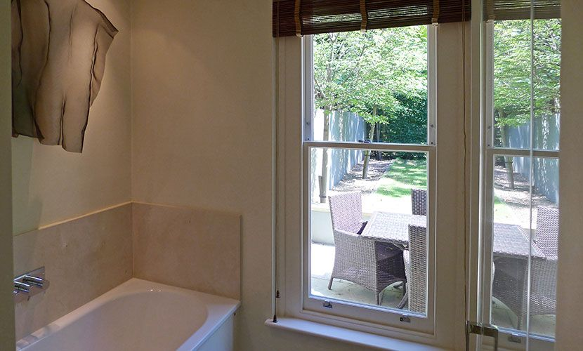Bathroom with bathtub and shower in the Chatham vacation rental offered by London Perfect
