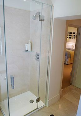 Glass enclosed shower in bathroom 1 of the Chatham vacation rental offered by London Perfect