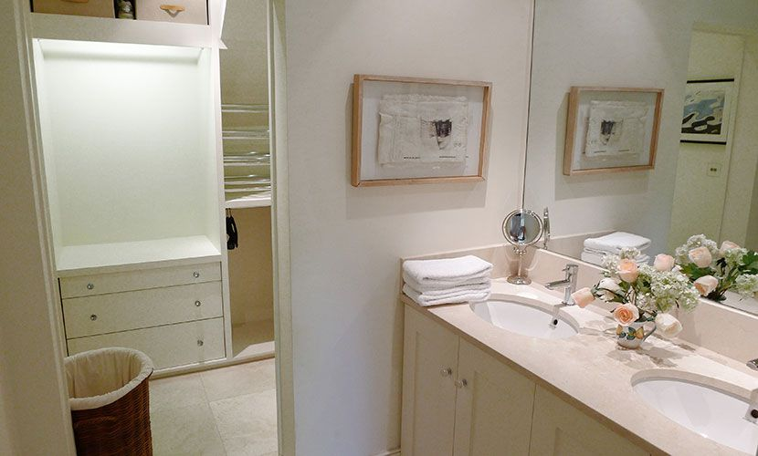 Double sinks and large mirror in first bathroom of the Chatham vacation rental