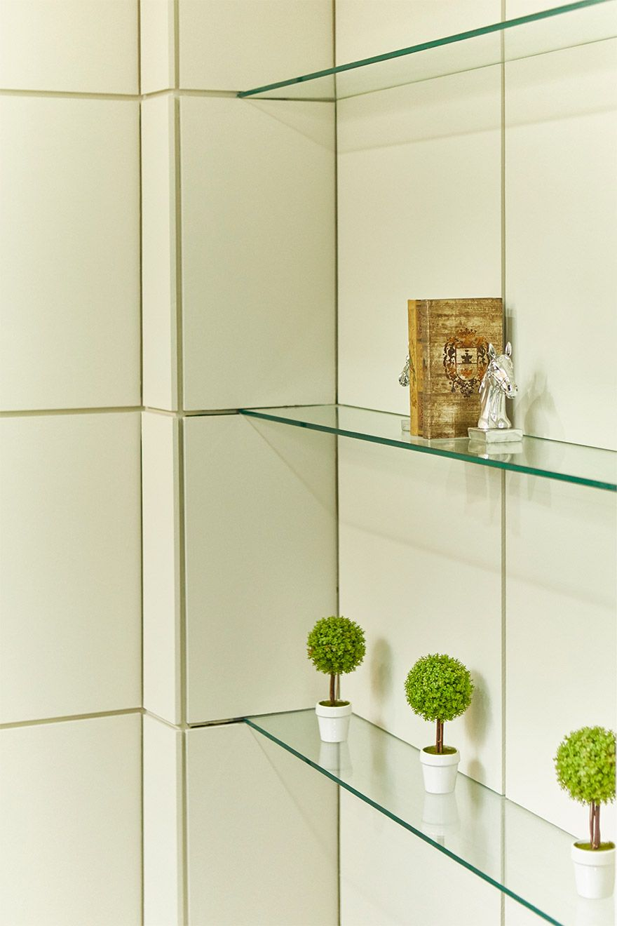 Delicate glass shelves in the living room of the Danebury vacation rental