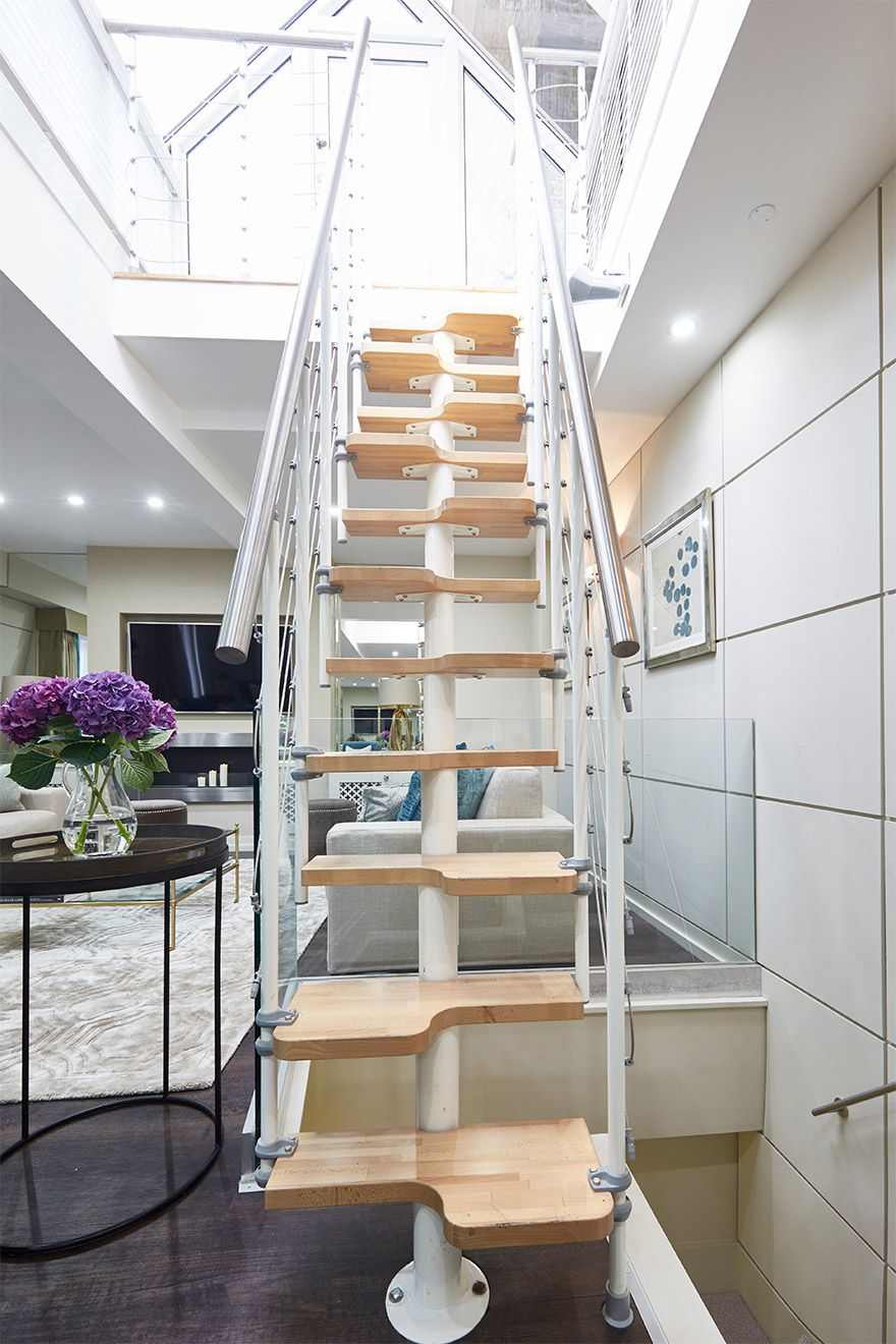 Elegant minimalist staircase in the Danebury vacation rental offered by London Perfect