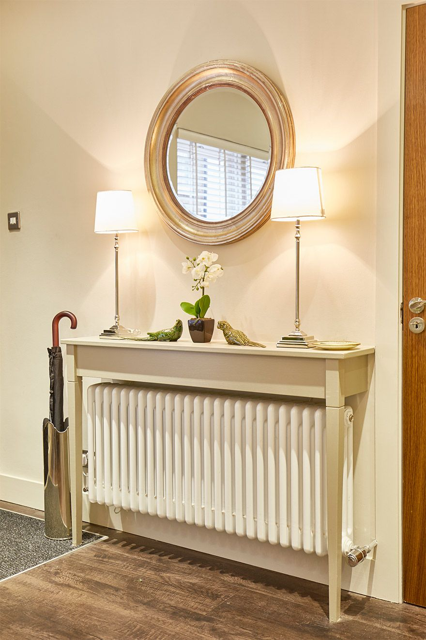 Delicate entry table with an umbrella stand in the Danebury vacation rental