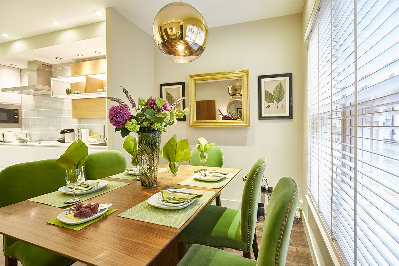 Dining table comfortably seats six in the Danebury vacation rental offered by London Perfect