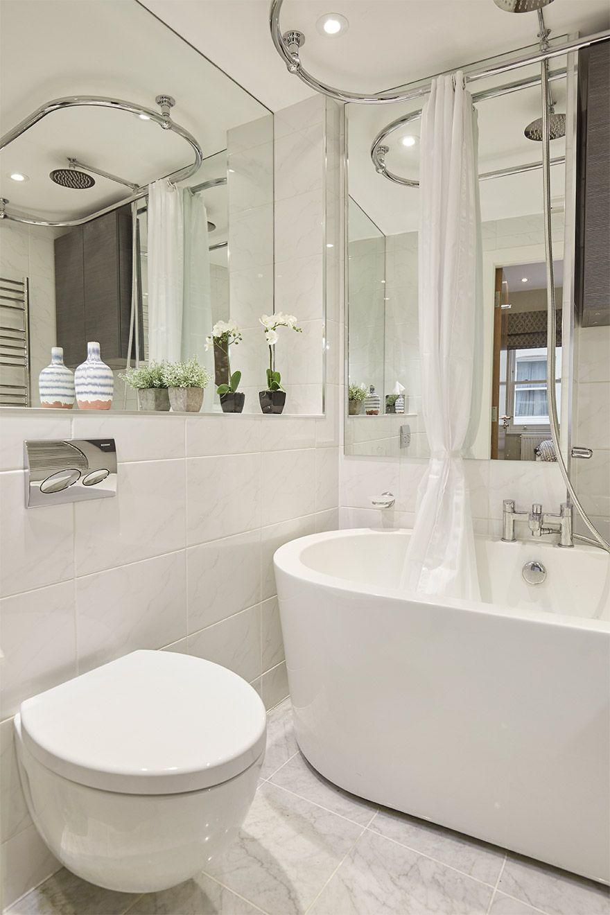 Second bathroom features a bath, toilet and sink in the Danebury vacation rental